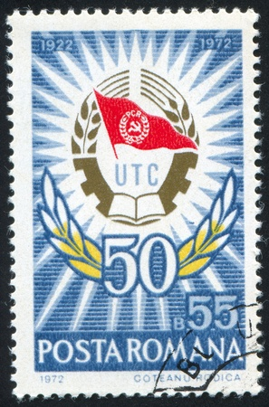 communists: ROMANIA - CIRCA 1972: stamp printed by Romania, shows young communists union emblem, circa 1972