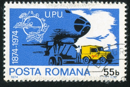 ROMANIA - CIRCA 1974: stamp printed by Romania, shows post car, circa 1974 Stock Photo - 11339282