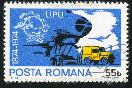 ROMANIA - CIRCA 1974: stamp printed by Romania, shows post car, circa 1974 Stock Photo - 11339282