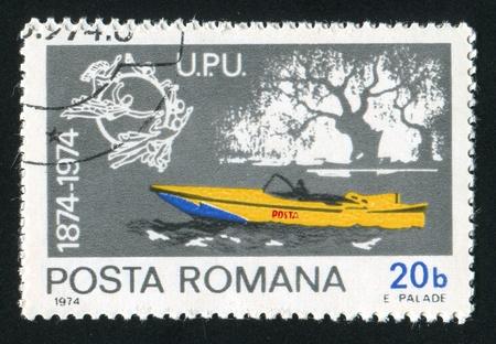 upu: ROMANIA - CIRCA 1974: stamp printed by Romania, shows mail motorboat and UPU emblem, circa 1974 Stock Photo