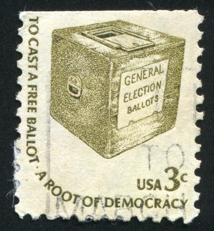 ballot box: UNITED STATES - CIRCA 1975: stamp printed by United States of America, shows early ballot box, circa 1975