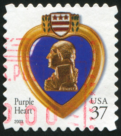UNITED STATES - CIRCA 2003: stamp printed by United States of America, shows purple heart, circa 2003 Stock Photo - 11339290