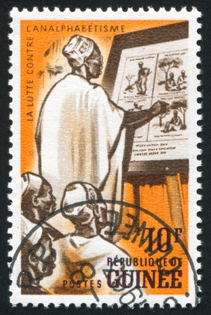GUINEA CIRCA 1962: stamp printed by Guinea, shows Adult class, circa 1962 photo