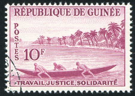 GUINEA CIRCA 1959: stamp printed by Guinea, shows Launching fishing pirogue, circa 1959 Stock Photo - 11371014