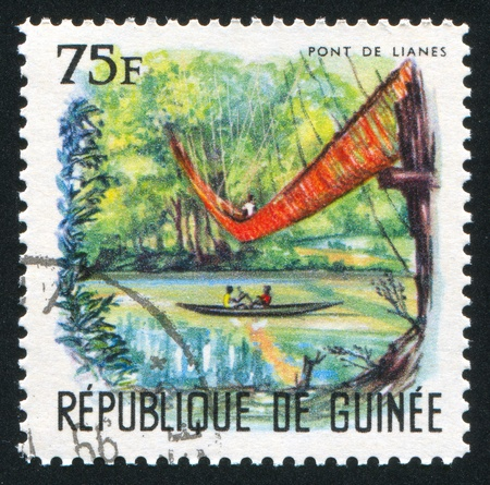 GUINEA CIRCA 1966: stamp printed by Guinea, shows Liana bridge, circa 1966 photo