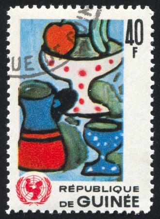GUINEA CIRCA 1966: stamp printed by Guinea, shows Still life, circa 1966 photo