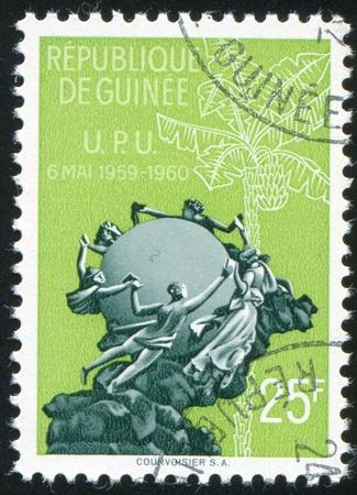 GUINEA CIRCA 1960: stamp printed by Guinea, shows Universal Postal Union Monument, circa 1960 photo