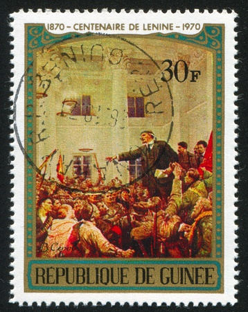 addressing: GUINEA CIRCA 1970: stamp printed by Guinea, shows Lenin Addressing Workers, by V. Serov, circa 1970