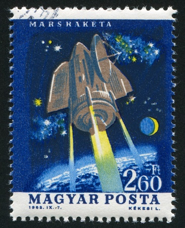 HUNGARY - CIRCA 1962: stamp printed by Hungary, shows satellite, circa 1962 photo