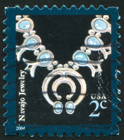 UNITED STATES - CIRCA 2004: stamp printed by United States of America, shows Navajo necklace, circa 2004 photo