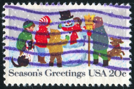 UNITED STATES - CIRCA 1982: stamp printed by United States of America, shows children with snowman, circa 1982 photo