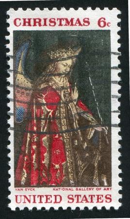 angel gabriel: UNITED STATES - CIRCA 1968: stamp printed by United States of America, shows angel Gabriel from van Eyck Annunciation, circa 1968 Stock Photo