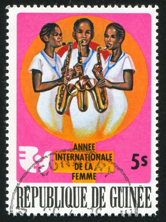 GUINEA CIRCA 1976: stamp printed by Guinea, shows Women Musicians, circa 1976 Stock Photo - 11452566