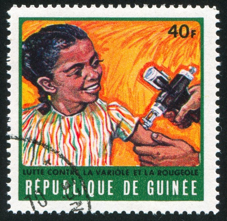 GUINEA CIRCA 1970: stamp printed by Guinea, shows Girl receiving vaccination, circa 1970 photo