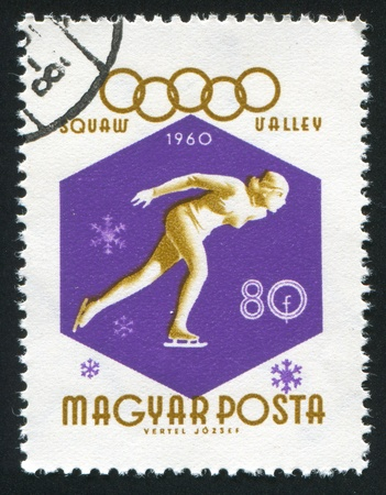 HUNGARY - CIRCA 1960: stamp printed by Hungary, shows skater, circa 1960 Stock Photo - 11457759