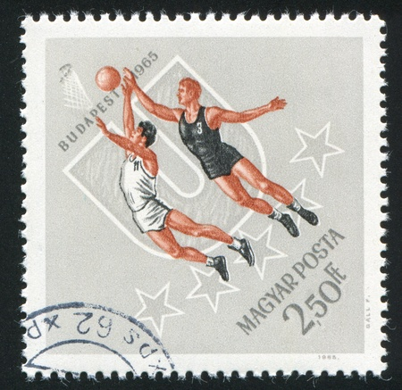 HUNGARY - CIRCA 1965: stamp printed by Hungary, shows basketball, circa 1965 photo