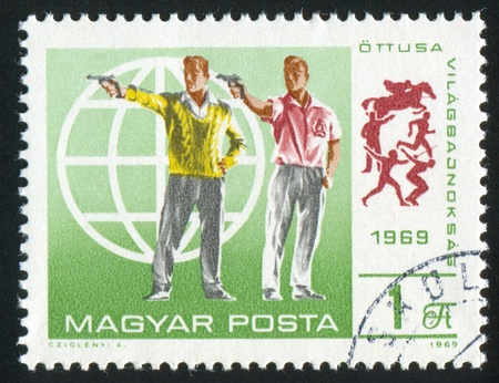 HUNGARY - CIRCA 1969: stamp printed by Hungary, shows shooting, circa 1969 photo