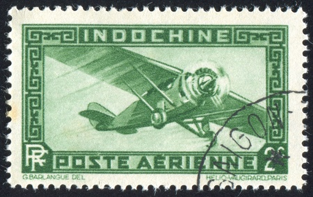 INDO-CHINA CIRCA 1933: stamp printed by Indo-China, shows Airplane, circa 1933 Stock Photo - 11448164