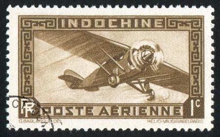 INDO-CHINA CIRCA 1933: stamp printed by Indo-China, shows Airplane, circa 1933 photo