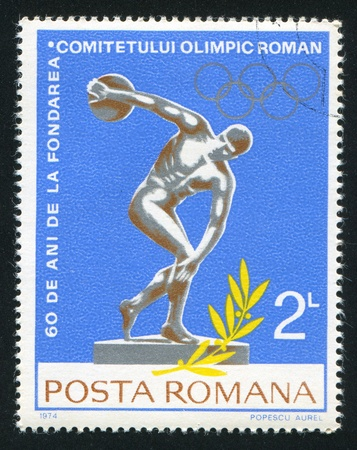 ROMANIA - CIRCA 1974: stamp printed by Romania, shows Discobolus and Olympic rings, circa 1974
