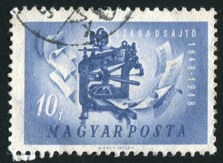 HUNGARY - CIRCA 1947: stamp printed by Hungary, shows printing press, circa 1947 photo