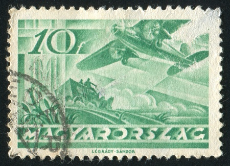 HUNGARY - CIRCA 1936: stamp printed by Hungary, shows Fokker F VII over Mail Coach, circa 1936 Stock Photo - 11754898