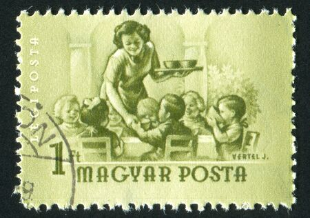lunchtime: HUNGARY - CIRCA 1954: stamp printed by Hungary, shows lunchtime at the Nursery, circa 1954 Stock Photo