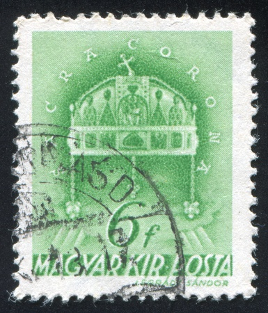 HUNGARY - CIRCA 1938: stamp printed by Hungary, shows Crown of St. Stephen, circa 1938 Stock Photo - 11754738