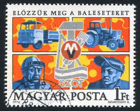 safety slogan: HUNGARY - CIRCA 1976: stamp printed by Hungary, shows Trucks, Safety Devices, Trade Union emblem, circa 1976 Editorial