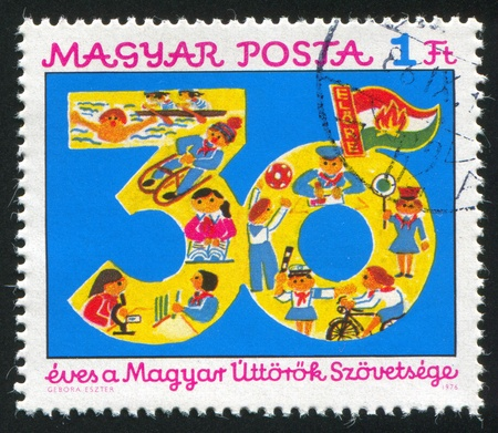 HUNGARY - CIRCA 1975: stamp printed by Hungary, shows 30 and various pioneer activities, circa 1975 photo