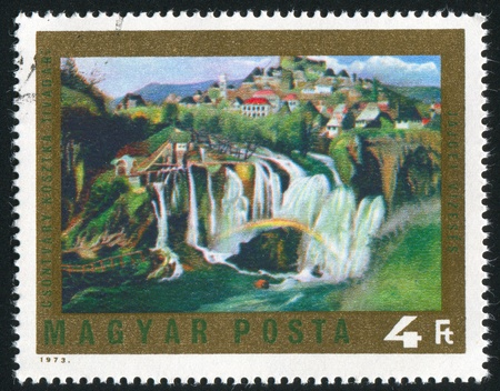 HUNGARY - CIRCA 1973: stamp printed by Hungary, shows picture Waterfall at Jajce by Csontvary Kosztka Tivadar, circa 1973 photo