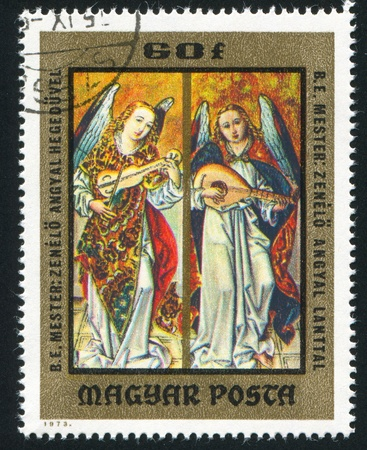 lute: HUNGARY - CIRCA 1973: stamp printed by Hungary, shows icon Angels playing violin and lute, circa 1973 Stock Photo