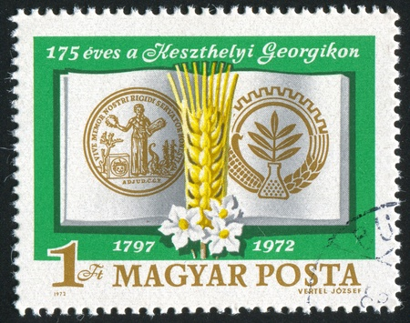 HUNGARY - CIRCA 1972: stamp printed by Hungary, shows Georgikon Emblems, Grain, Potato, Flower, circa 1972 photo