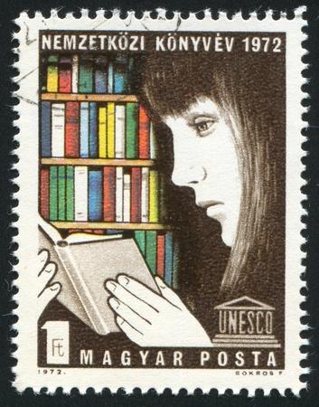 HUNGARY - CIRCA 1972: stamp printed by Hungary, shows reading girl, circa 1972 photo