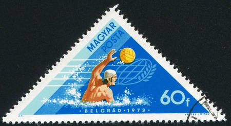 HUNGARY - CIRCA 1973: stamp printed by Hungary, shows Water polo, circa 1973 photo