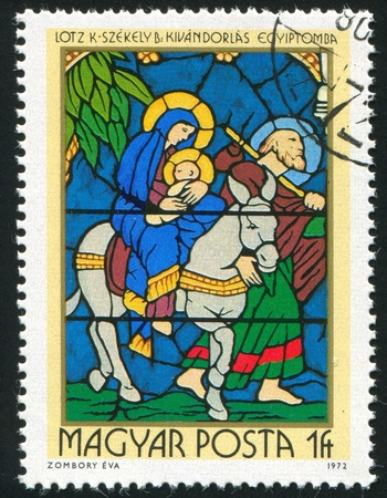 HUNGARY - CIRCA 1972: stamp printed by Hungary, shows Stained-glass Window, Flight into Egypt, by Karoly Lotz and Bertalan Szekely, circa 1972 photo