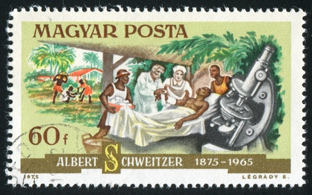 HUNGARY - CIRCA 1975: stamp printed by Hungary, shows Dr. Schweitzer, patient and microscope, circa 1975 Stock Photo - 11755786