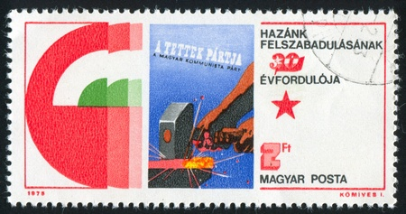HUNGARY - CIRCA 1975: stamp printed by Hungary, shows Poster Hungarian Communist Party-a Party of Action, circa 1975 photo