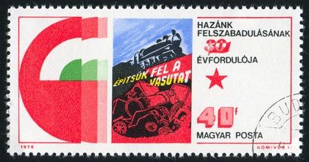 HUNGARY - CIRCA 1975: stamp printed by Hungary, shows Poster 'Let us Build up the Railroads', circa 1975 Stock Photo - 11755985