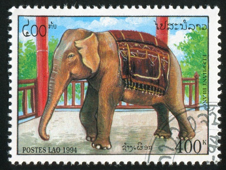 LAOS CIRCA 1994: stamp printed by Laos, shows Elephant Beside railing, circa 1994 Stock Photo - 11755905