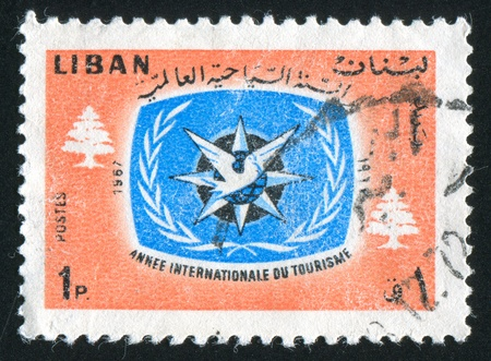 cedars: LEBANON CIRCA 1967: stamp printed by Lebanon, shows International Tourism Year Emblem and Cedars, circa 1967 Stock Photo
