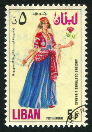 costume jewelry: LEBANON CIRCA 1973: stamp printed by Lebanon, shows Woman with Rose, circa 1973 Stock Photo