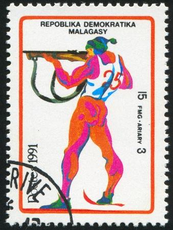 backsight: MALAGASY CIRCA 1991: stamp printed by Malagasy, shows Biathlon, circa 1991