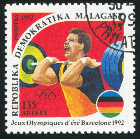 MALAGASY CIRCA 1992: stamp printed by Malagasy, shows Weight lifting, circa 1992 Stock Photo - 11755919