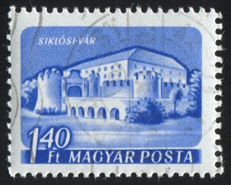 HUNGARY - CIRCA 1960: stamp printed by Hungary, shows Siklos Castle, circa 1960 photo