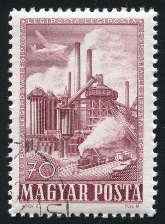 HUNGARY - CIRCA 1950: stamp printed by Hungary, shows factory, Steel mill, circa 1950 photo