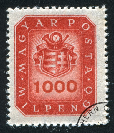 HUNGARY - CIRCA 1946: stamp printed by Hungary, shows emblem, circa 1946 photo
