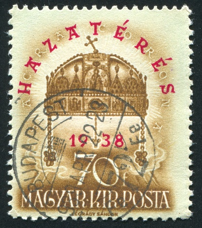 HUNGARY - CIRCA 1938: stamp printed by Hungary, shows Crown of St. Stephen, circa 1938 Stock Photo - 11893094