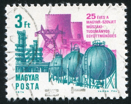 peace pipe: HUNGARY - CIRCA 1974: stamp printed by Hungary, shows High Voltage Line Peace and Pipe Line Friendship, circa 1974 Stock Photo