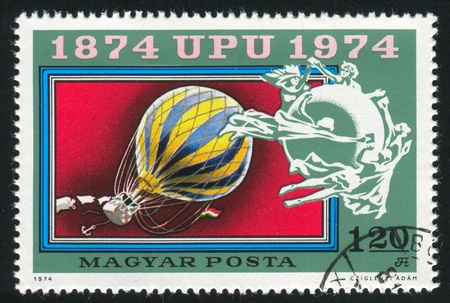 HUNGARY - CIRCA 1974: stamp printed by Hungary, shows Balloon Post,  UPU Emblem, circa 1974 photo